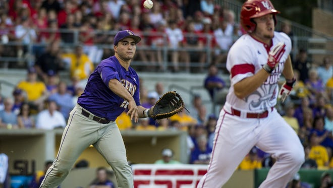 LSU Tigers catcher Chris Chinea (26) throws out UL Ragin' Cajuns infielder Joe Robbins (12) during last season's June 7 NCAA Super Regional game at Alex Box Stadium in Baton Rouge. The Tigers defeated the Cajuns 6-3 to capture the NCAA Super Regional championship and advance to the College World Series in Omaha, Nebraska.