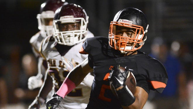 Cocoa's Timmy Pratt takes the ball 36 yards for a Tiger TD during their game against Astronaut.