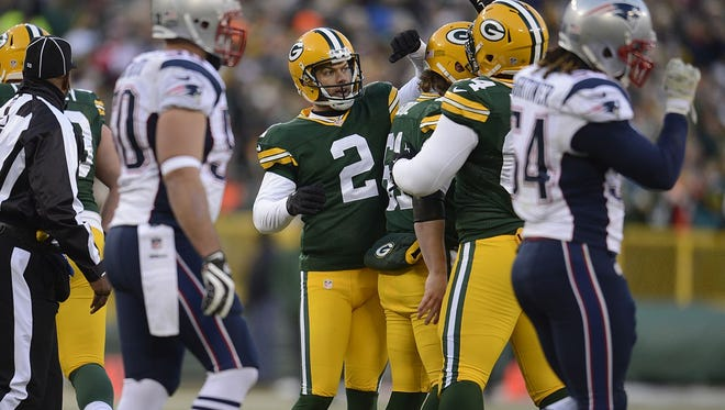 Green Bay Packers kicker Mason Crosby celebrates with his teammates after making a field goal against the New England Patriots in the first quarter during Sunday's game at Lambeau Field.