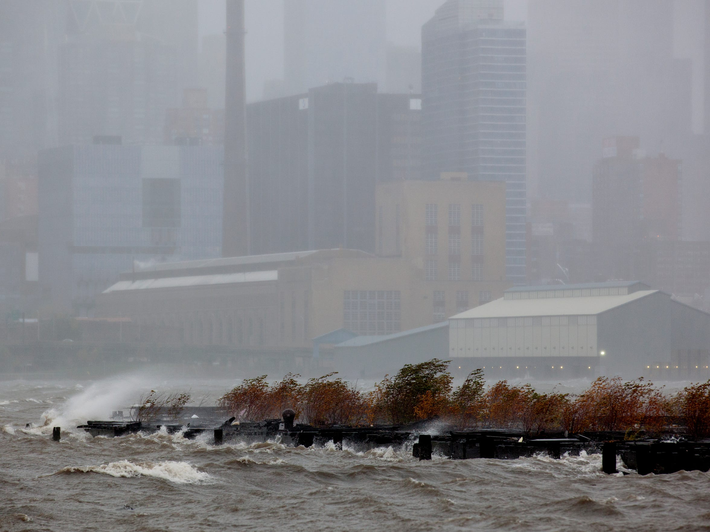 Wind-blown mist from the Hudson River, along with driving rain in West New York, N.J., fills the air on Oct. 29, 2012 as Hurricane Sandy lashes the East Coast. Manhattan is visible in the background.