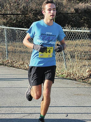 Spencer Hales appears to be in his comfort zone during a successful road race outing in February at the Central Classic 5K in Bartlesville. Mike Tupa/Examiner-Enterprise