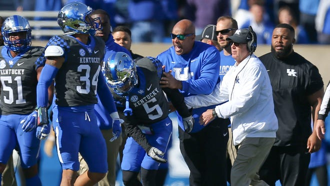 Kentucky and Louisville scuffled and fought after UK linebacker Jordan Jones and U of L quarterback Lamar Jackson exchanged shoves near the goal line Saturday in the first quarter. Nov. 25, 2017