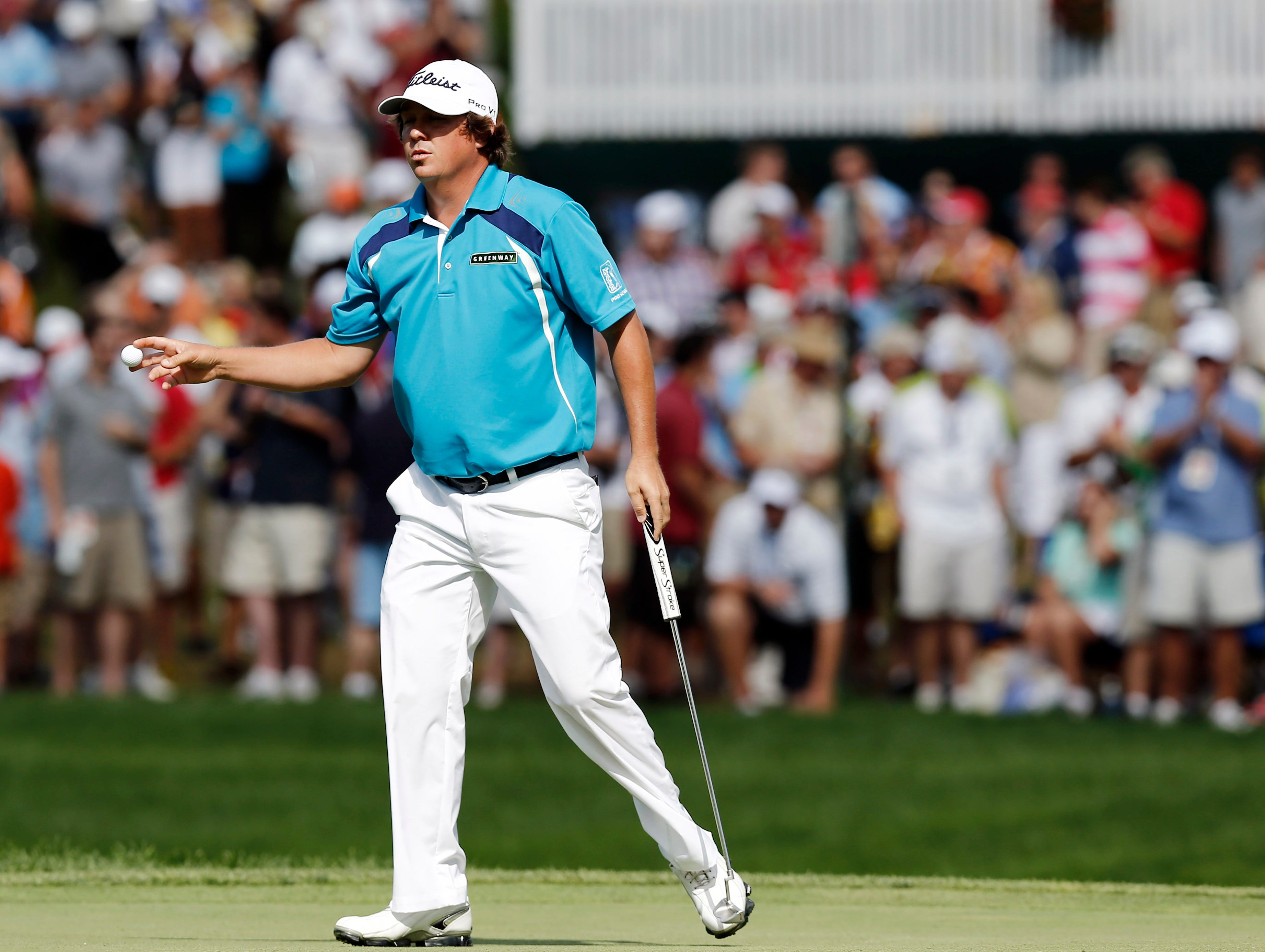 Jason Dufner grabs his ball on the No. 6 hole.