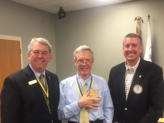 Rotary Incoming President Dorsey Ridley, Rotary Outgoing President Bruce Eblen, and Rotary First Vice President Mark Chumbler with the Star Designation.