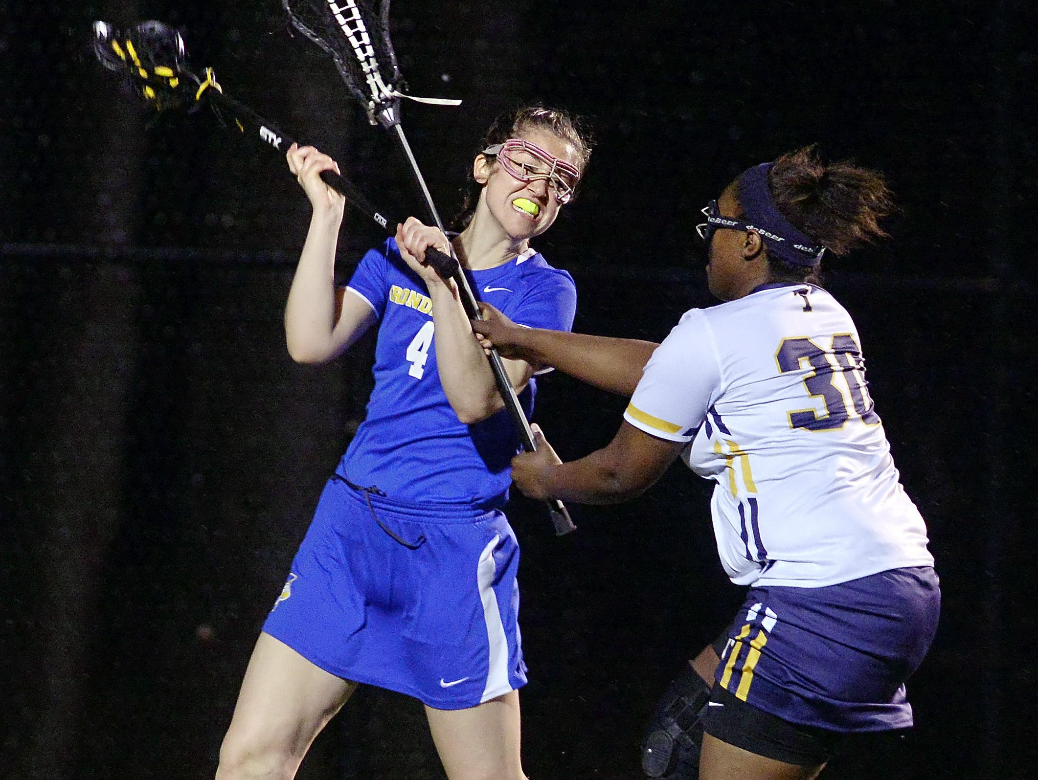 Webster Thomas' Amber Breedy, right, defends against Irondequoit's Mary Clare Bowes.