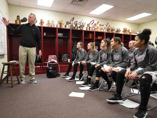 Lady Colonel head coach Jeff Haile talks to his team before taking the floor as the Henderson County Lady Colonels play the South Warren Spartans at Henderson's Colonel Gym Friday, February 9, 2018.