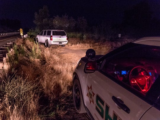 Tulare County Sheriffs Department investigates along the Kaweah River on Road 212 at the Kaweah River in Woodlake on Tuesday, June 26, 2018. A 7-month-old fell from a raft in the river and went downstream, out of sight from the family. A friend of the family found the baby in the water on the other side of Road 212 but was also overcome by the river and had to be pulled from the water. Both are in critical condition.