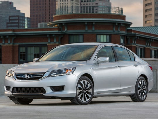 This photo provided by Honda shows the 2014 Honda Accord