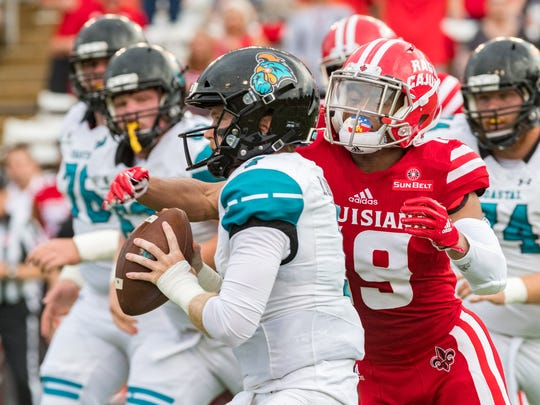 Ragin' Cajuns cornerback Eric Garror sacks Coastal Carolina quarterback Bryce Carpenter last season.