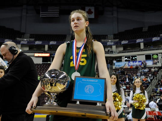 York Catholic's Morgan Klunk holds the PIAA Class AA runner-up trophy while watching Bishop Canevin players receive their championship trophy on Friday, March 22, 2013, at the Giant Center. York Catholic lost 45-38. (DAILY RECORD/SUNDAY NEWS -- CHRIS DUNN)