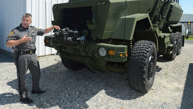 """Sheriff Mike Lewis and a """"small contingent of officers"""" are currently in the city, along with the county's recently acquired bullet-proof armored vehicle, Deputy Chief Gary Baker said."""