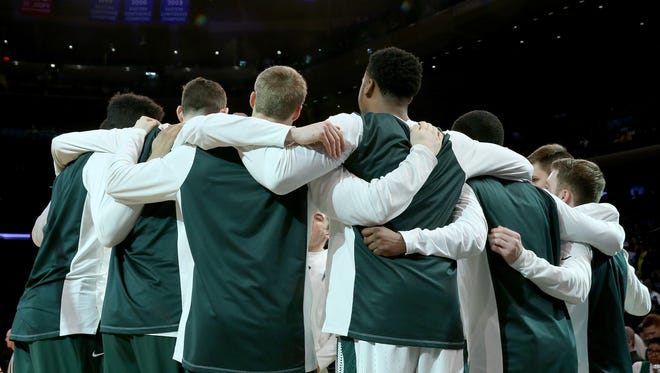 The Michigan State Spartans huddle before the game against the Wisconsin Badgers during quarterfinals of the Big Ten Basketball Tournament at Madison Square Garden on March 2, 2018 in New York City.
