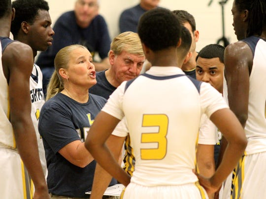 Coach Dawn McNew plans out a play with her players during a time out at Lehigh's game against Sarasota Christian during the Wally Keller Classic on Saturday, Jan. 17.