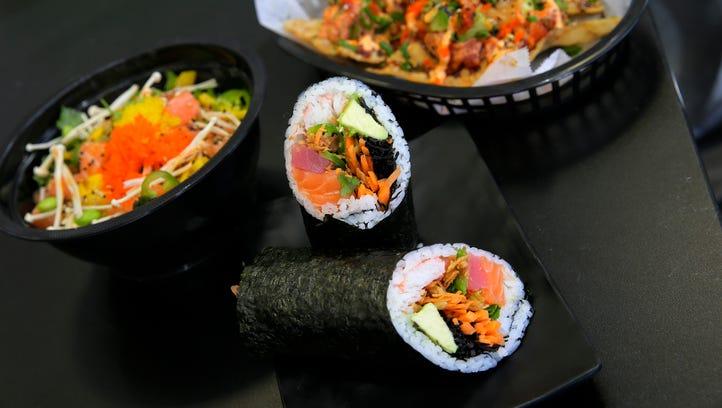 From Yuzu Kitchen in  Manalapan, salmon poké (from left),  Japanese nachos and a Titan sushi burrito.