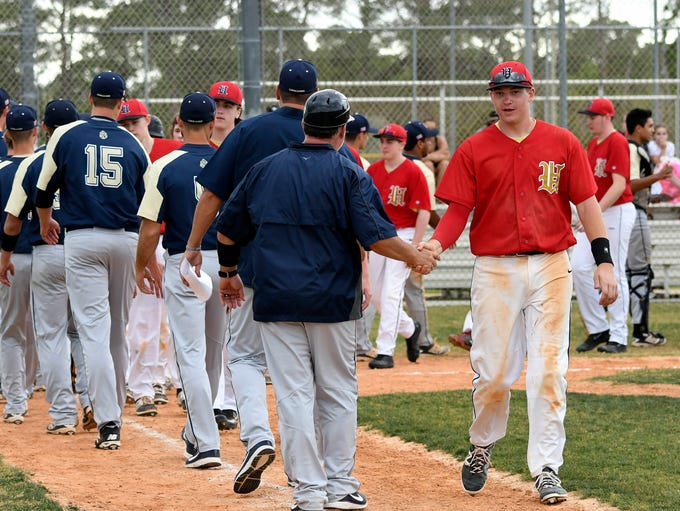 Players from Eau Gallie and University shake hands