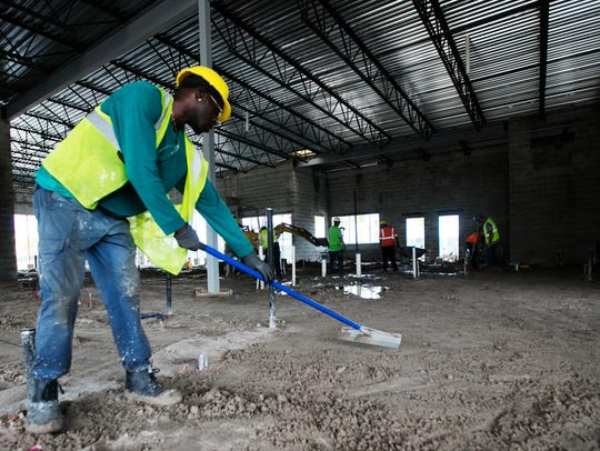 Isaac Riley works on an eatery that is being built