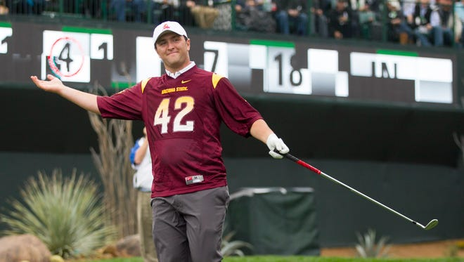 Jan 31, 2015: ASU student Jon Rahm tries to excite the crowd before teeing off on the 16th hole stadium during the third round of the Waste Management Phoenix Open at TPC Scottsdale.