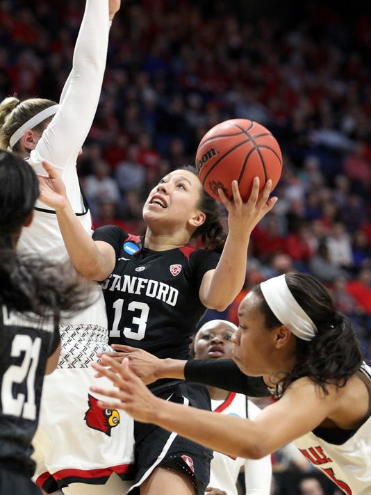 Stanford's Marta Sniezek (13) shoots while defended by Louisville's Sam Fuehring, left, and Asia Durr, right, during the second half of an NCAA women's college basketball tournament regional semifinal, Friday, March 23, 2018, in Lexington, Ky. (AP Photo/James Crisp)