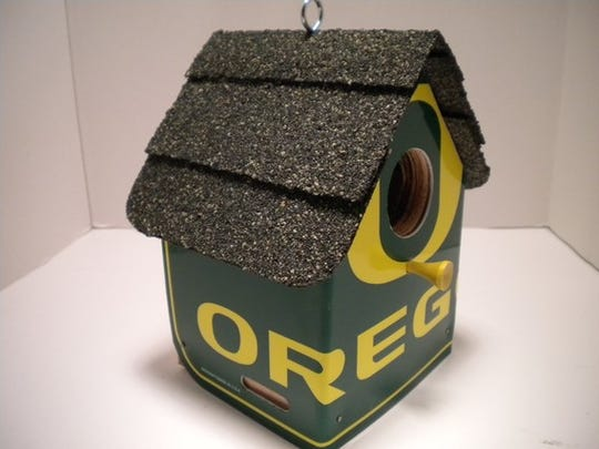 Albany resident Brian Agee uses University of Oregon license plates to create birdhouses and clocks.
