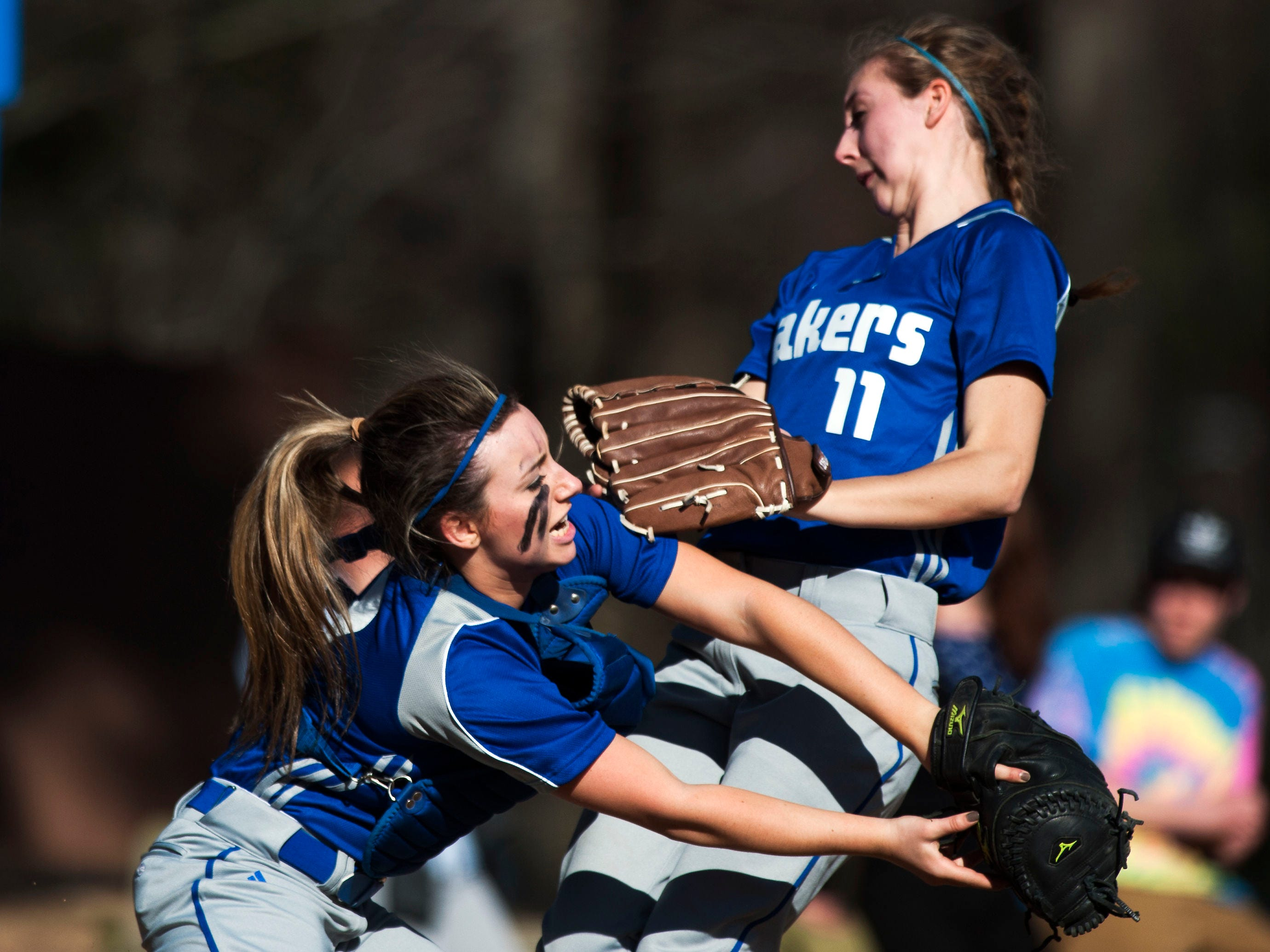 Colchester's Jordan Schrabel (7) collides with Brittany Isatelle (11) as she catches a fly ball during the girls high school softball game between the Missisquoi Thunderbirds and the Colchester Lakers at Colchester High School on Tuesday afternoon in Colchester.