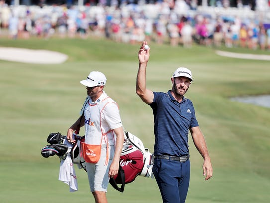 Dustin Johnson reacts aftrer holing out on the 18th