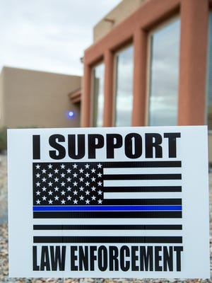 A free yard sign supporting law enforcement is posted in front of a home off Roadrunner Parkway on Wednesday, December 21, 2016.