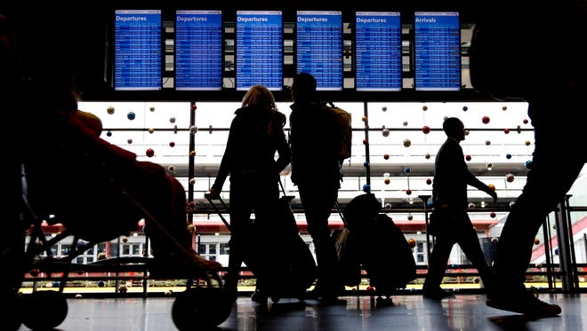 Travelers walk to their gates at Chicago O'Hare International Airport on Nov. 29, 2015.