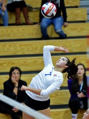 Reno High's Kyra Johannessen goes up for the spike