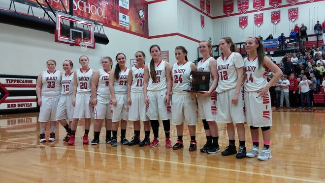 The Cardinals receive their trophy after falling short against Fort Loramie, 45-31, in their regional final on Saturday night.