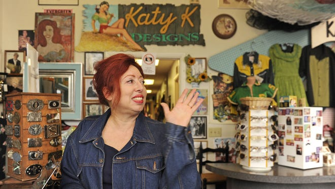 Katy Kattelman, owner of Katy K Designs and Ranch Dressing,  waves goodbye to  a customer Saturday. Her shop will be closing in May.