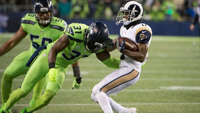 Seahawks safety Kam Chancellor lines up a hit on Rams receiver Tavon Austin on Dec 15, 2016, in Seattle. Chancellor, whose hard-hitting style is among the reasons he's a favorite of teammates, is awaiting a contract extension.