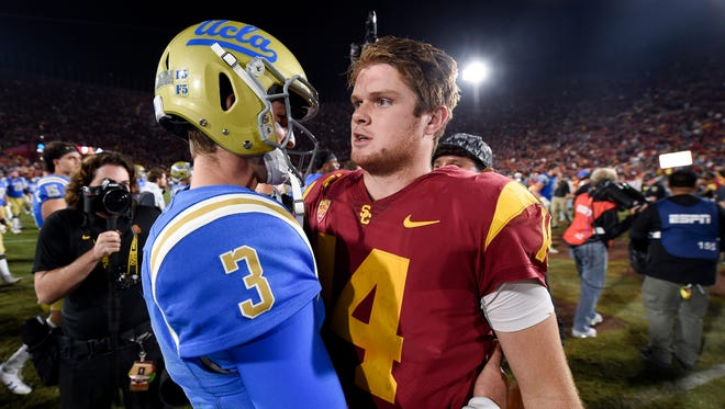 NFL mock draft: Southern California Trojans quarterback Sam Darnold (right) and UCLA Bruins quarterback Josh Rosen (3) could be very high picks in the 2018 NFL draft.