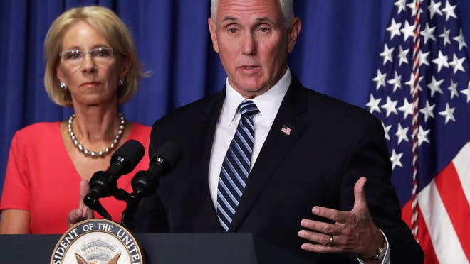 U.S. Vice President Mike Pence speaks as Secretary of Education Betsy DeVos listens during a White House Coronavirus Task Force press briefing at the U.S. Department of Education July 8, 2020 in Washington, DC. Vice President Pence and the task force members discussed the latest on the COVID-19 pandemic and the reopening of nation's schools in the fall.