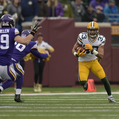 Green Bay Packers' Micah Hyde (33) runs with the ball