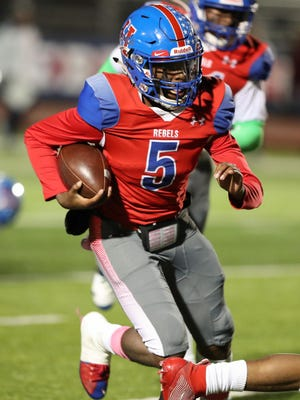 Hays quarterback Durand Hill, scoring in this 2019 game against Westlake, had 301 total yards to help his team defeat Austin High 41-35 in a district showdown.
