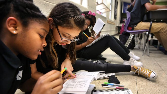 Aspire Coleman seventh-graders Dasia Madison, left, and Ashley Morazan work together during a lesson in Erayna Price's humanities class in this file photo.