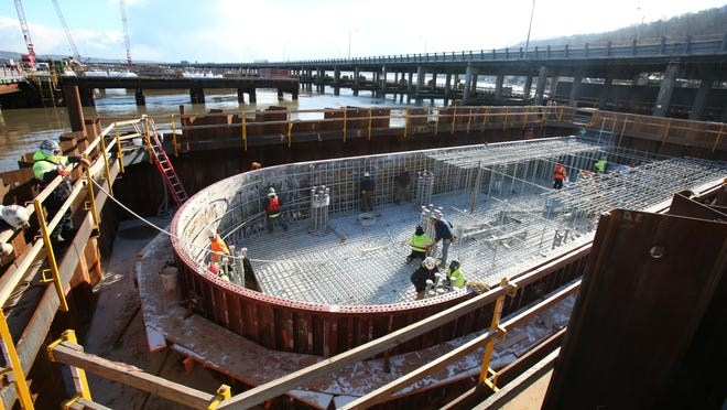 Workers set reinforced steel rods to ready it for concrete during construction of a pile cap for the new Tappan Zee Bridge, near the Rockland shore Jan. 7, 2015.