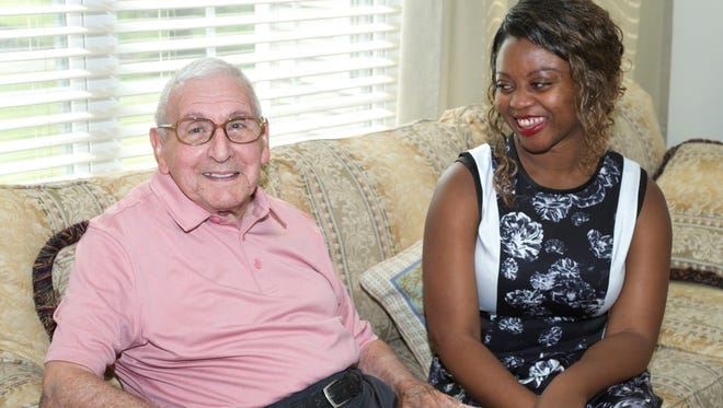 """""""We get along so well ... as if we have known each other for years,"""" said Joe Hertling, 94, when asked about Tina Tucker of the VNA Health Group."""