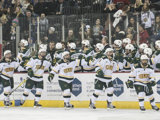 Vermont celebrates a goal during the men's hockey game between the Vermont Catamounts and the Quinnipiac Bobcats in the championship game of the Friendship Four hockey tournament at the SSE Arena on Saturday evening November 26, 2016 in Belfast, Northern Ireland.