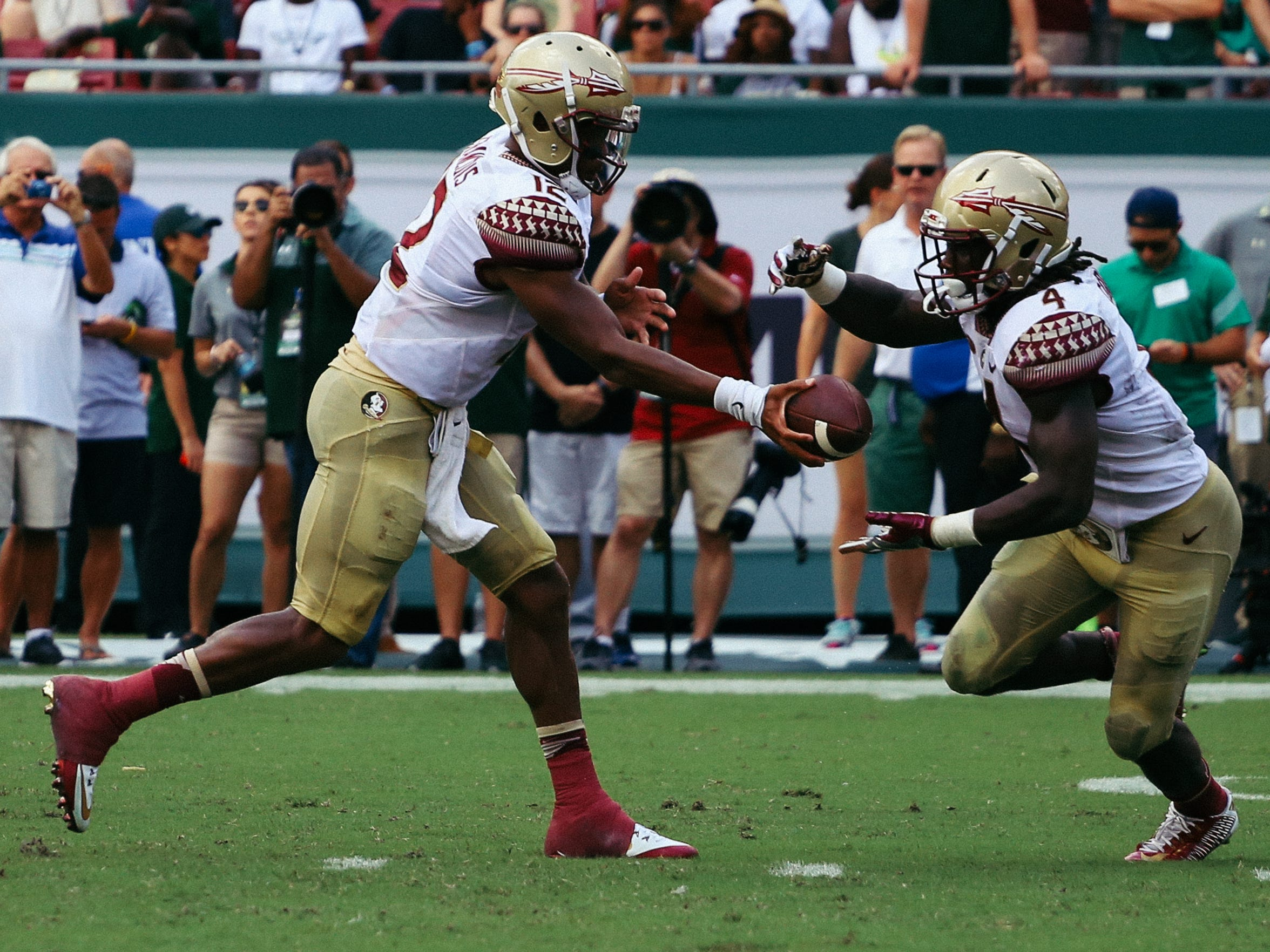 Deondre Francois (12) hands the ball off to Dalvin Cook (4) during the first half against USF at Raymond James Stadium. Cook added four catches for 64 yards in the contest.