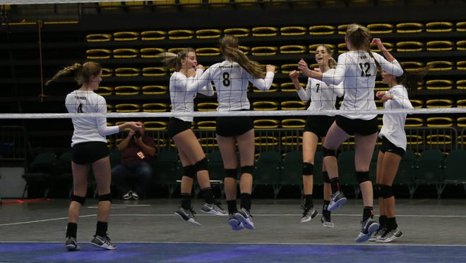 Desert Hills volleyball players celebrate at the 3A State tournament at UVU Wednesday, October 26, 2016.