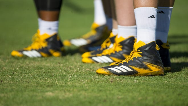 ASU player cleats during practice at Kajikawa practice fields at Arizona State University in Tempe on August 24, 2017.