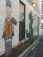 Street art of Jerry Smith, downtown Lafayette's street sweeper, is part of a mural in the alley connecting Main and Columbia streets, between Main and Sixth streets. A new monument to Smith is being installed on Fifth Street, less than a block away.