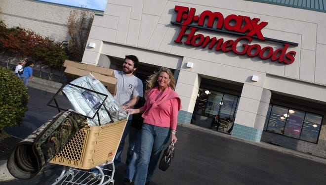 Reid Scelza of Nashville and his mother, Kim Johnson of Park City, Utah, walk out of T.J. Maxx HomeGoods in Brentwood with a cart full of home furnishings in 2005.