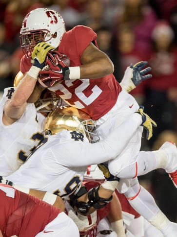 Stanford running back Remound Wright (22) goes over