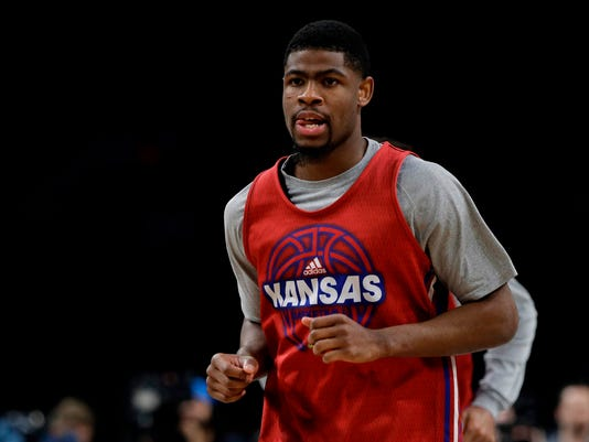 Kansas guard Malik Newman runs on the court during a practice session for the Final Four NCAA college basketball tournament, Friday, March 30, 2018, in San Antonio. (AP Photo/David J. Phillip)