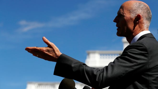 Florida Gov. Rick Scott talks to the media outside the West Wing of the White House in Washington, Friday, Sept. 29, 2017, after having lunch with President Donald Trump Vice President Mike Pence.