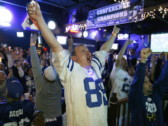 Colts fan Chris Green celebrates while watching a game.