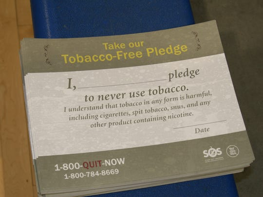 Seventh and eighth graders at Cotter Junior High School signed this pledge Tuesday as part of National Kick Butts Day to never use tobacco products.