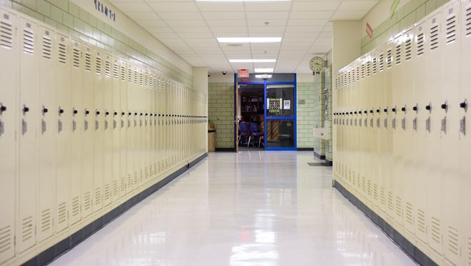 A hallway lined with lockers at the 94-year-old Whittier Middle School which has no room for additions and features small classrooms. With the school district releasing a new master facilities plan later this year the building's future is uncertain.